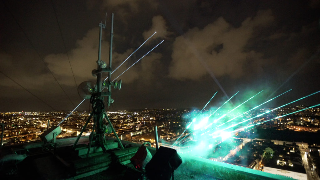 Lasers mounted on the top of Sussex Heights looking out to the Brighton skyline