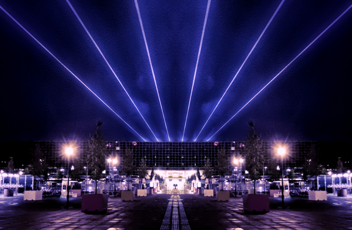 Artist's mockup of Milton Keynes station building at night with 6 blue/white lasers emanating from the roof